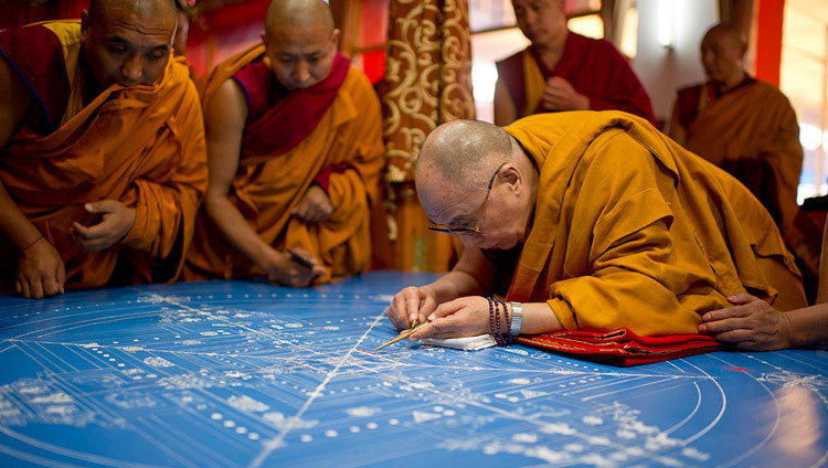 His Holiness the Dalai Lama placing the first grains of colored sand to start the construction of the Kalachakra sand mandala during the 32nd Kalachakra Empowerment in Bodhgaya, Bihar, India on January 1, 2012. (Photo by Tenzin Choejor/OHHDL)