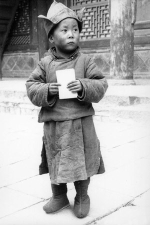 His His Holiness the Dalai Lama at the age of four at Kumbum Monastery in Amdo, Eastern Tibet.